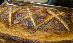 Cooked pastry containing a nut & mushroom filling, brown, shiny and crispy looking