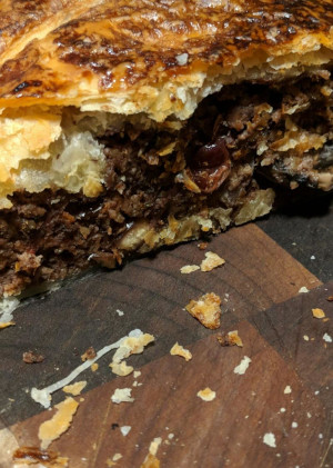 Same pastry dish from before but sliced open revealing the nut and mushroom filling