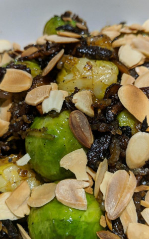 Brussel sprouts with stick mushrooms, shallots and covered with a sprinkling of toasted almond flakes