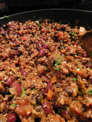 "Vegan chilli ""non"" carne, kidney and black beans, vegetables, vegan mince in a brown, spicy sauce with some coriander"