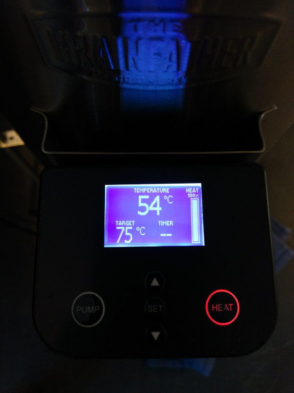 The Grainfather blue LED panel displaying current temperature whilst it heats the strike water