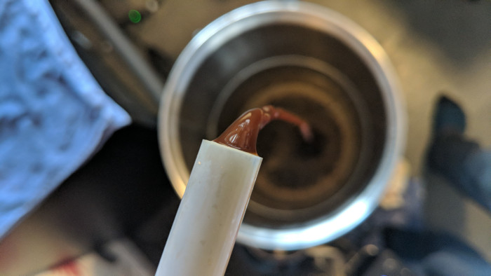 Photo of the stout being transferred to keg